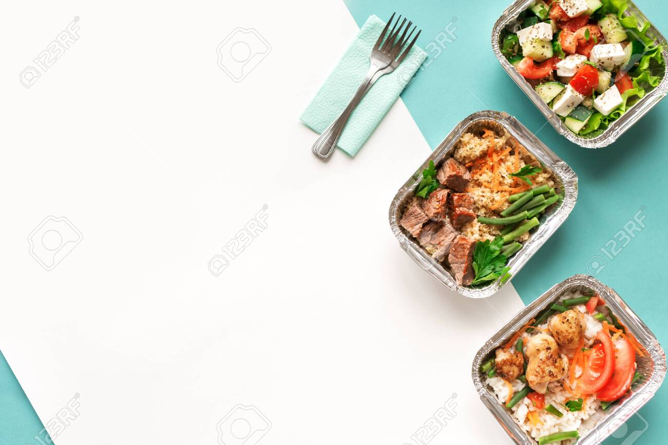 Healthy food delivery. Take away of organic daily meal on blue, copy space. Clean eating concept, healthy food, fitness nutrition take away in foil boxes, top view. - 128969356