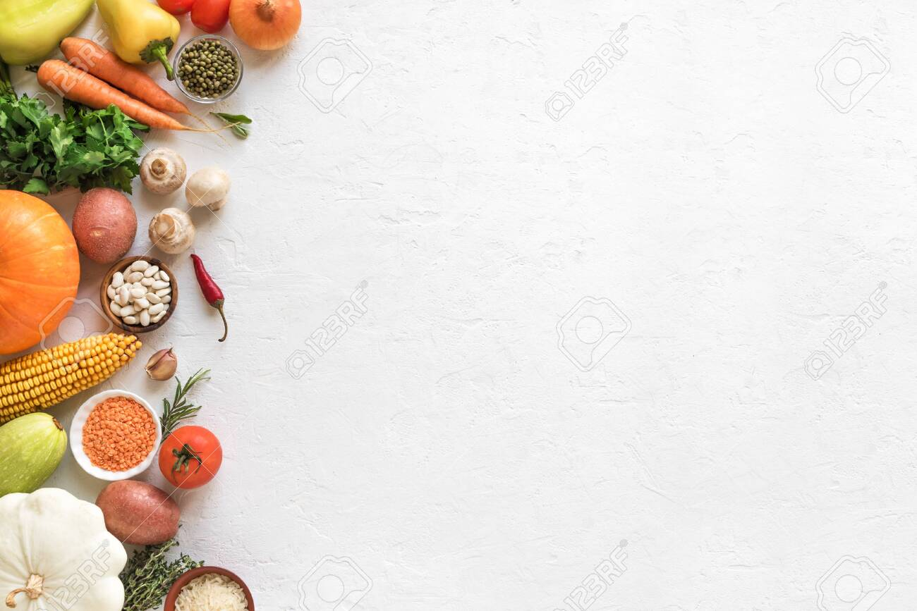 Vegetarian cooking background with seasonal organic vegetables and grains on white, top view, banner. Ingredients for vegan vegetarian seasonal soups and dishes. - 129908476