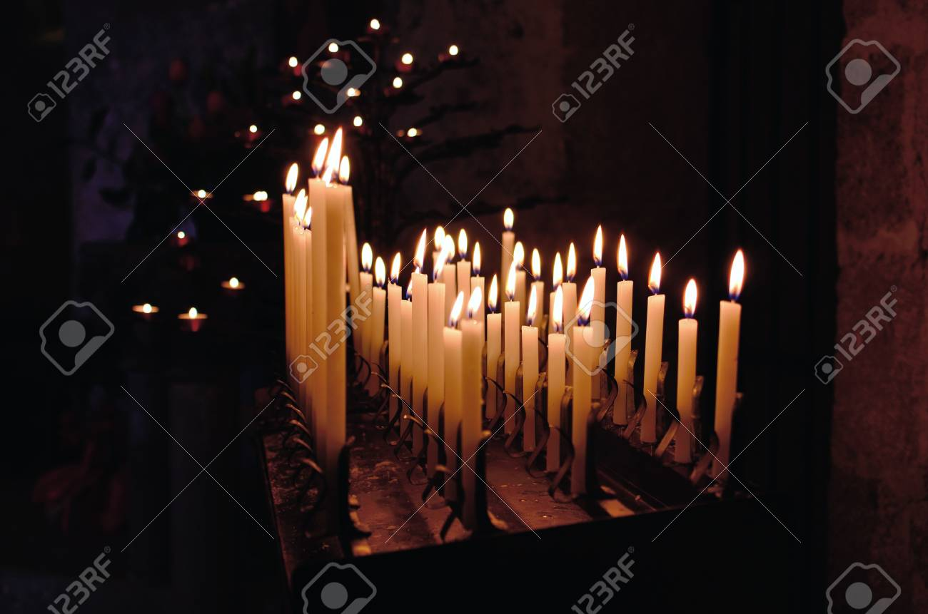 Some church candles against a dark background Stock Photo - 13125615