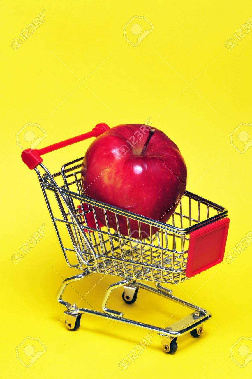 Apple in a shopping cart. Stock Photo - 4976123