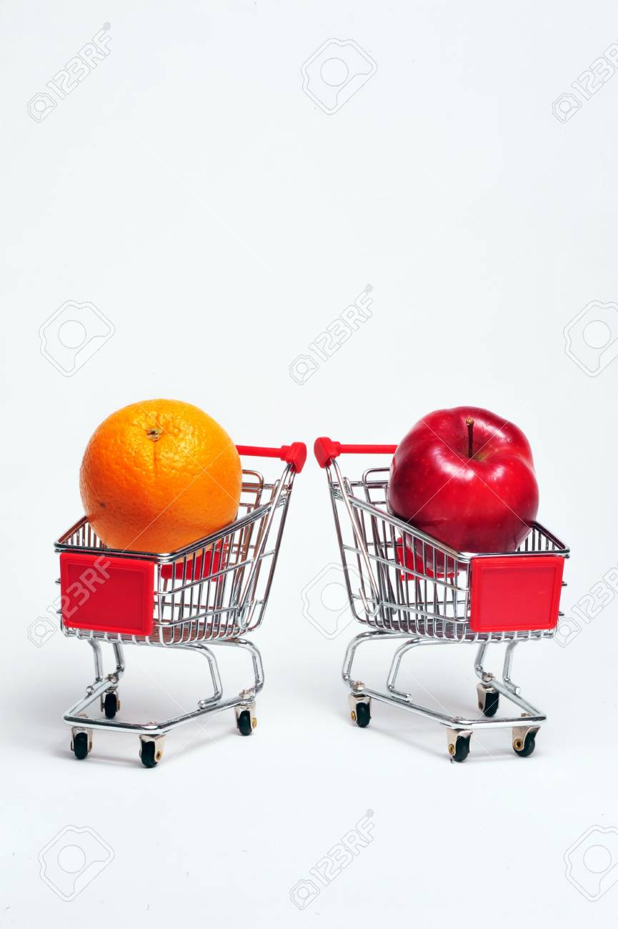 Orange and Apple in a cart Stock Photo - 4976116