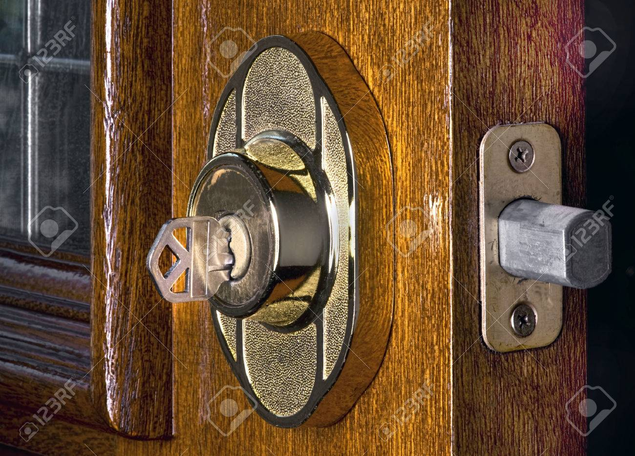 Deadbolt Lock On Mahogany Front Door Stock Photo Picture And