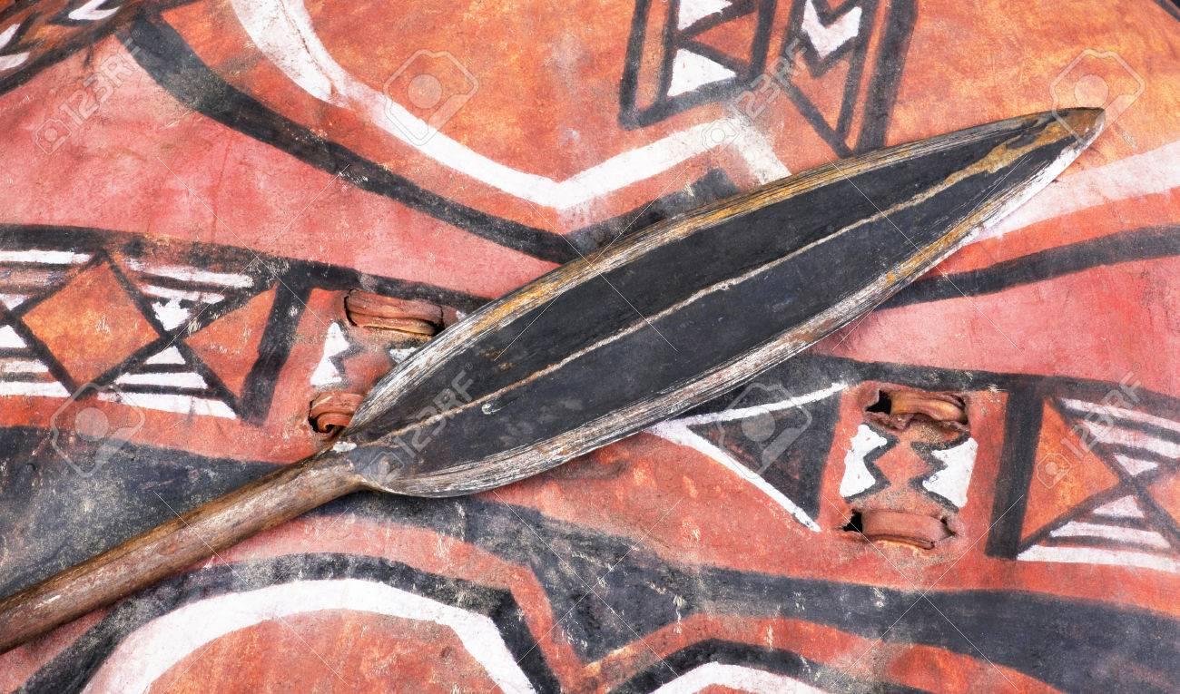 African Maasai spear head on skin shield