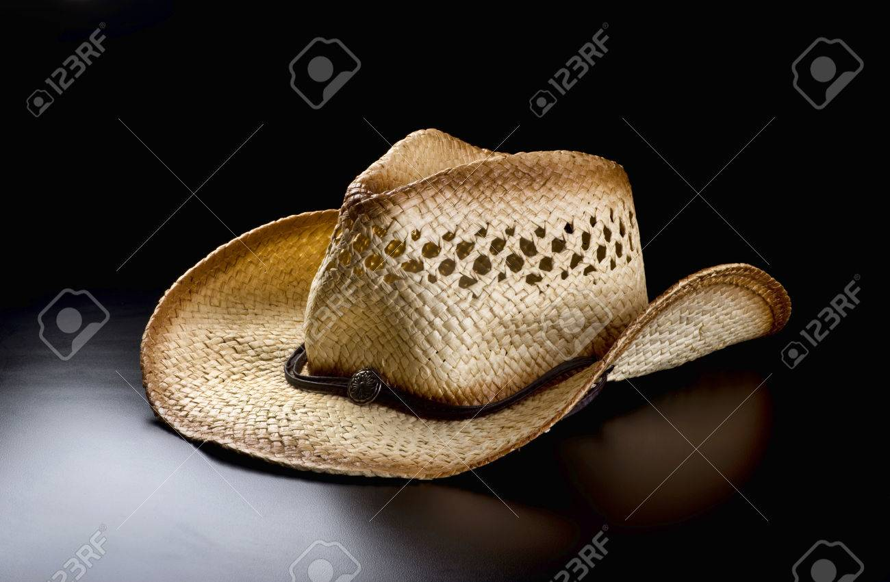 2a4ce5c3bdb5d Old straw cowboy hat. Stock Photo - 83674841