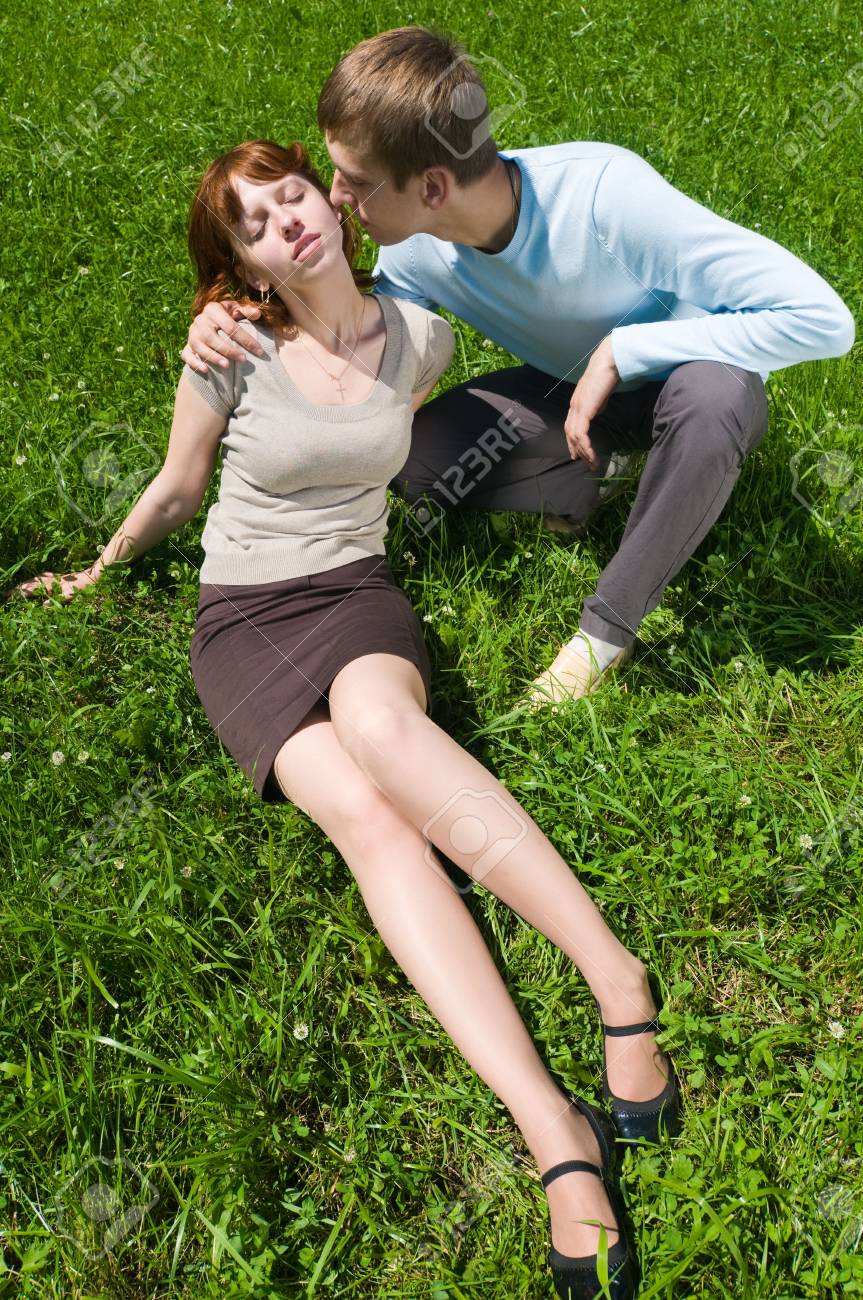 Young lovers on the grass in the green park Stock Photo - 5716117