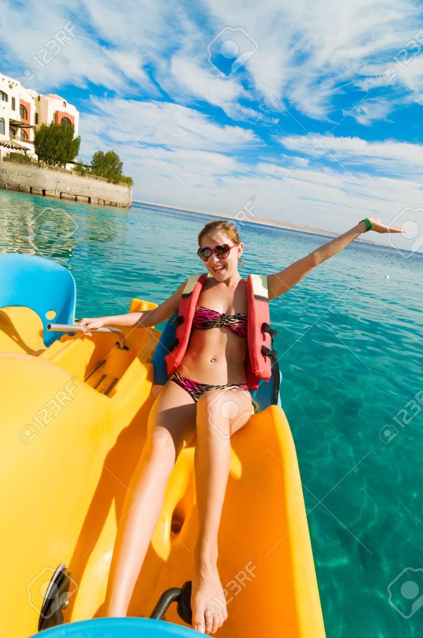 Cheerful young woman riding catamaran Stock Photo - 13603749