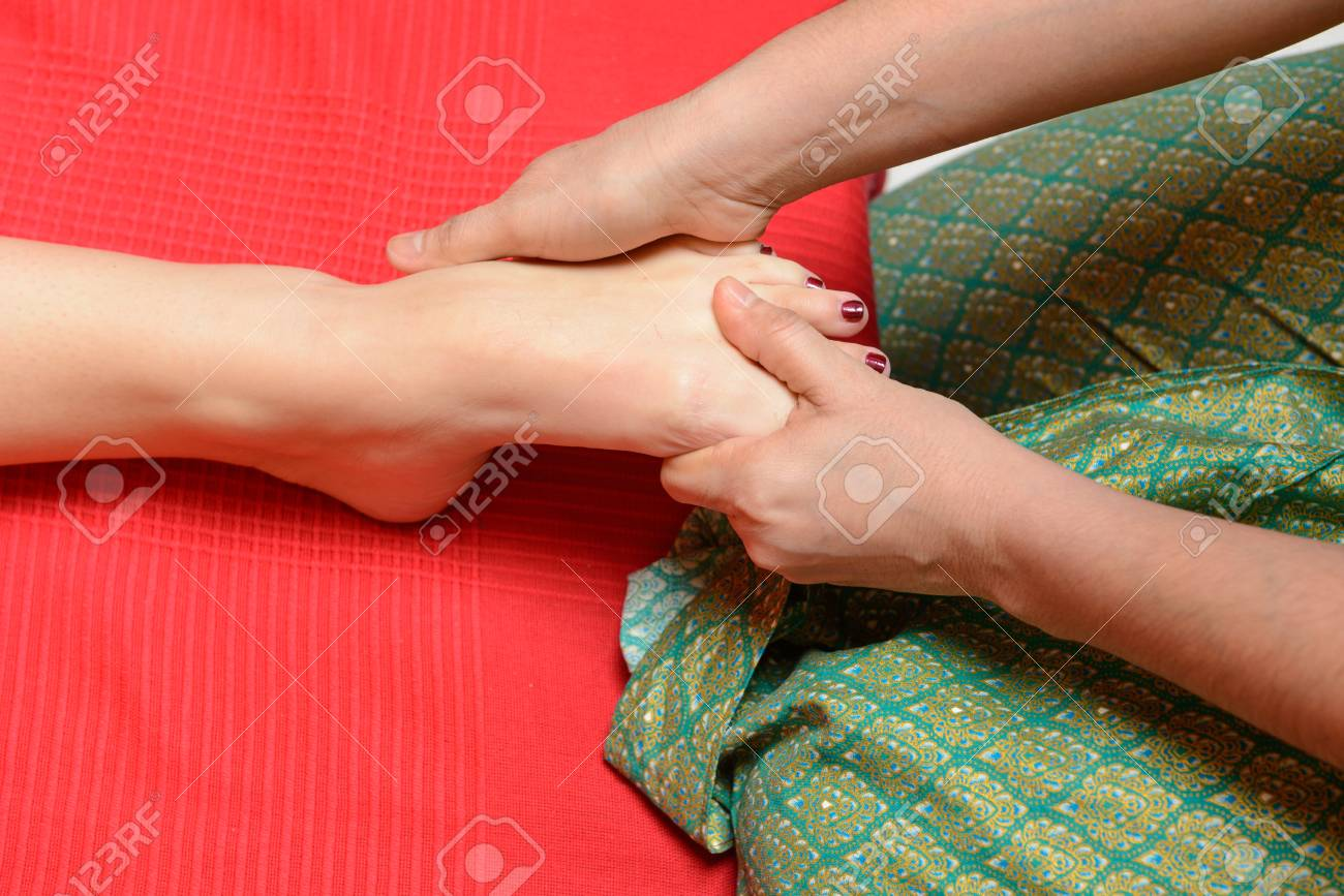 Young woman enjoying traditional thai foot massage Stock Photo - 22609502