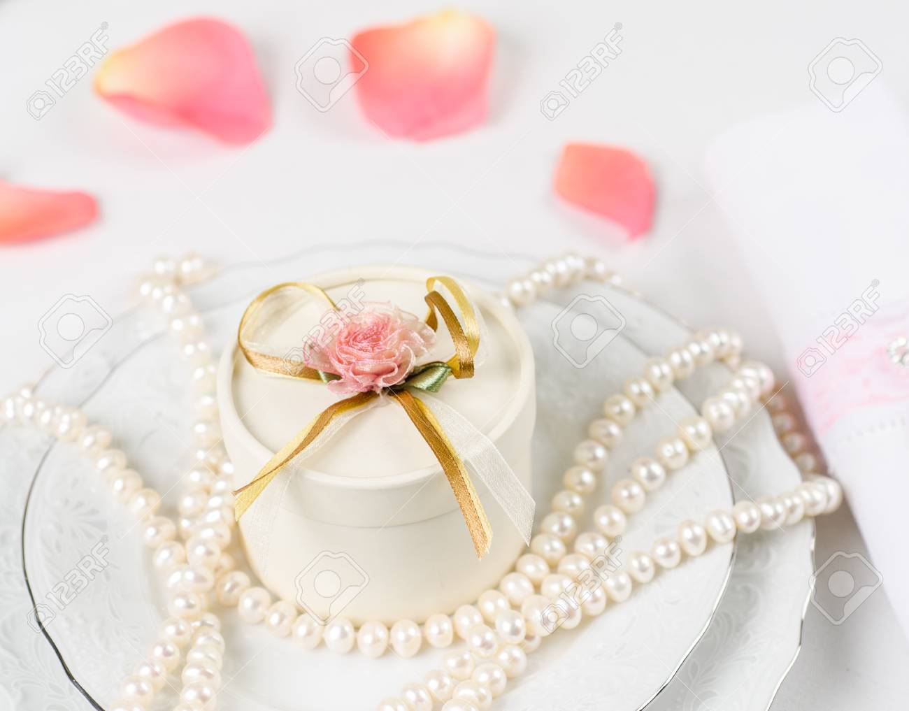 Wedding Table Accessories With Rose Petals And Pearls Stock Photo