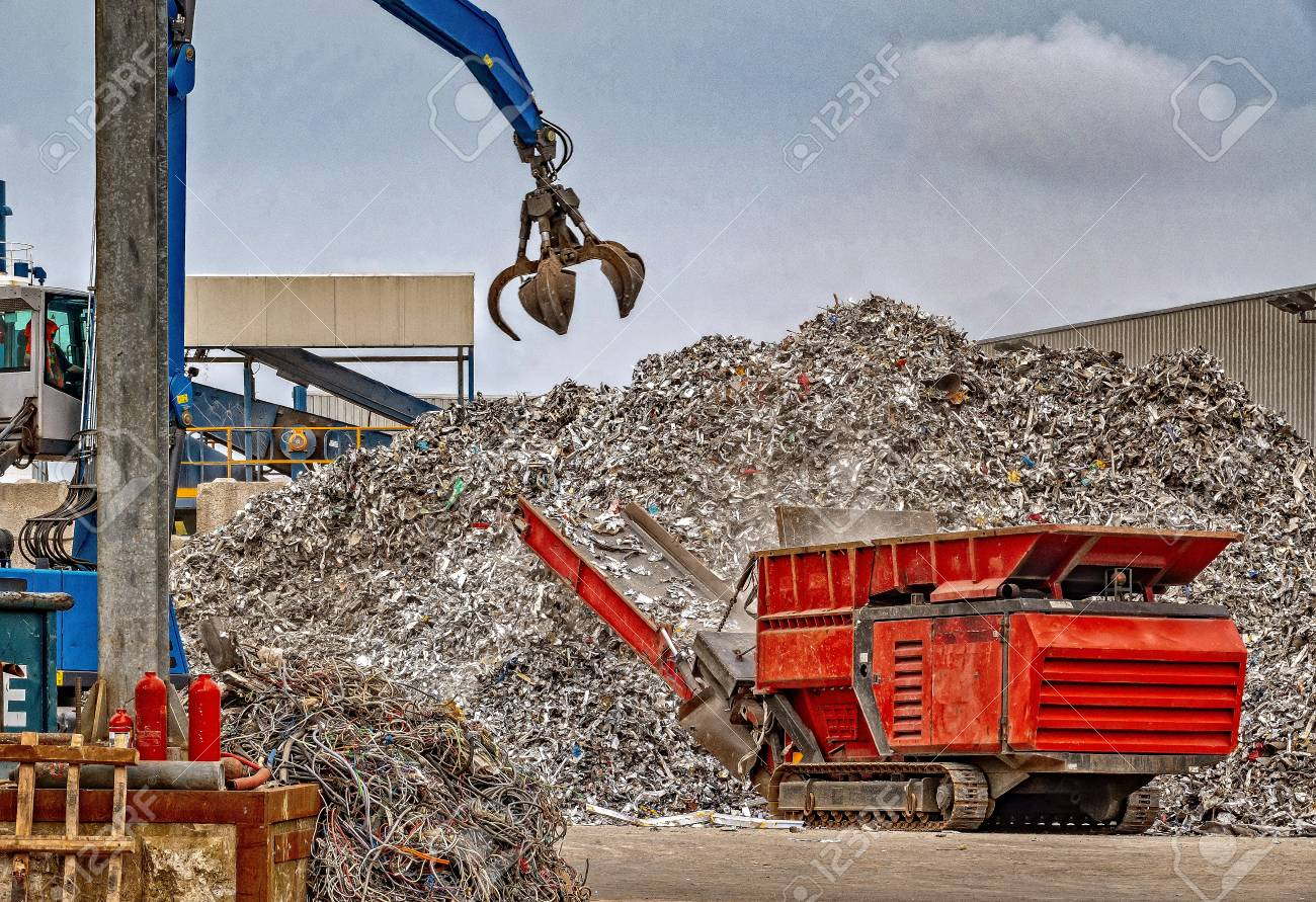 Recycling scrap metal at a waste management facility - 115695411