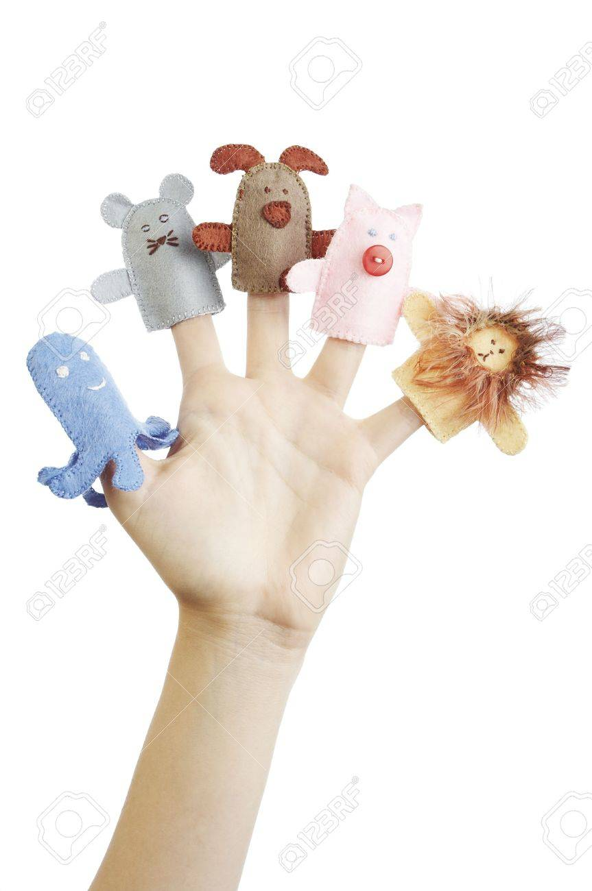 Girl's hand with animal finger puppets (pig, lion, mouse, octopussy, dog) Stock Photo - 580853