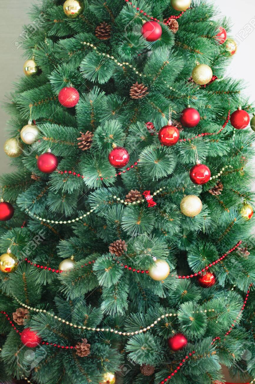 Artificial Christmas Tree Decorated In Traditional Red And Gold Stock Photo Picture And Royalty Free Image Image 128231883