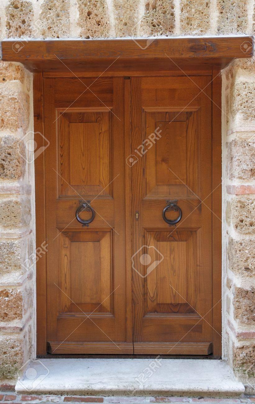 elegant wooden door with knockers Stock Photo - 9285953