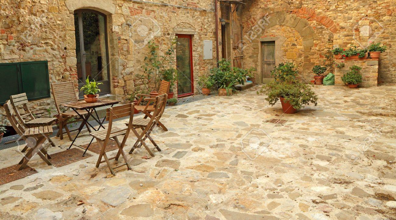 paved rustic terrace in tuscany italy europe stock photo