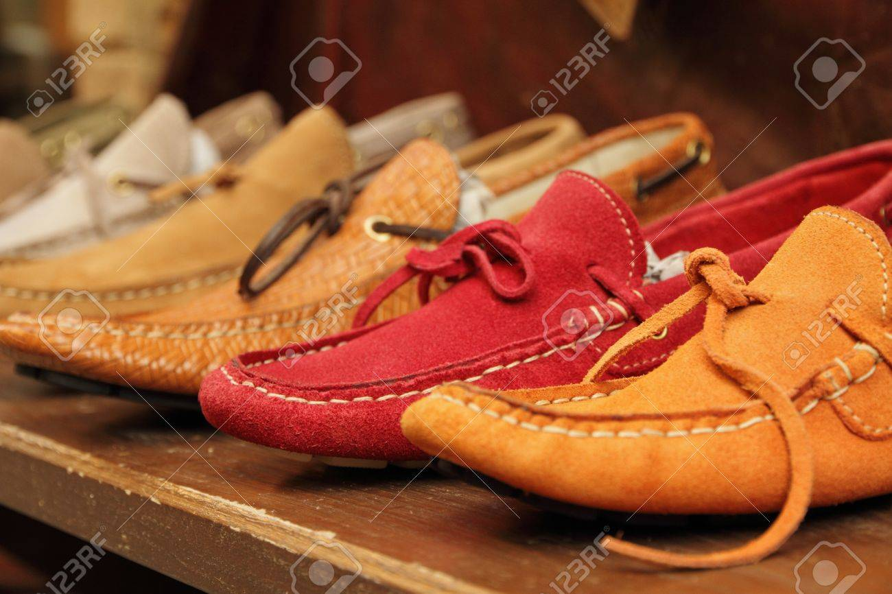 Colorful Moccasins Style Shoes On Shelf