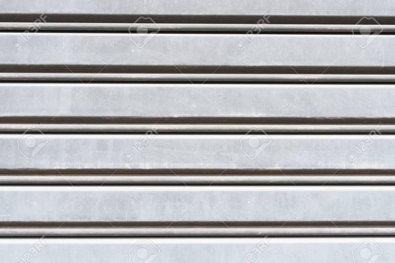 Iron Shutter Door Or Garage And Rolling Door Texture. Stock Photo   79488048