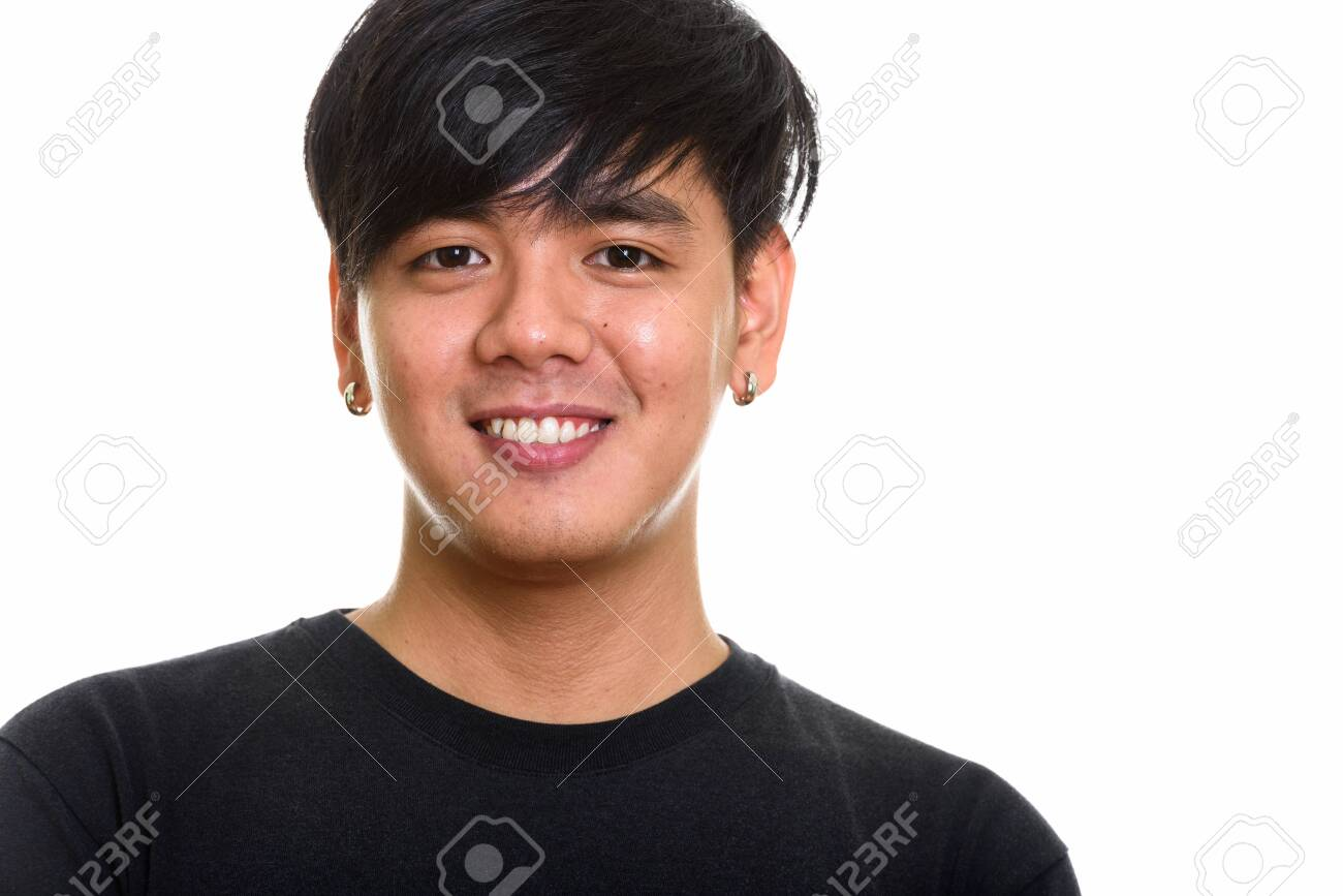 Studio shot of cool happy Asian man smiling - 123803899
