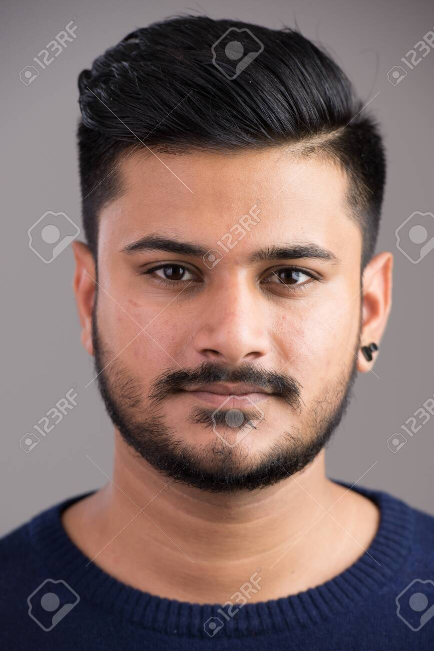 Face of young handsome Indian man looking at camera - 131283526