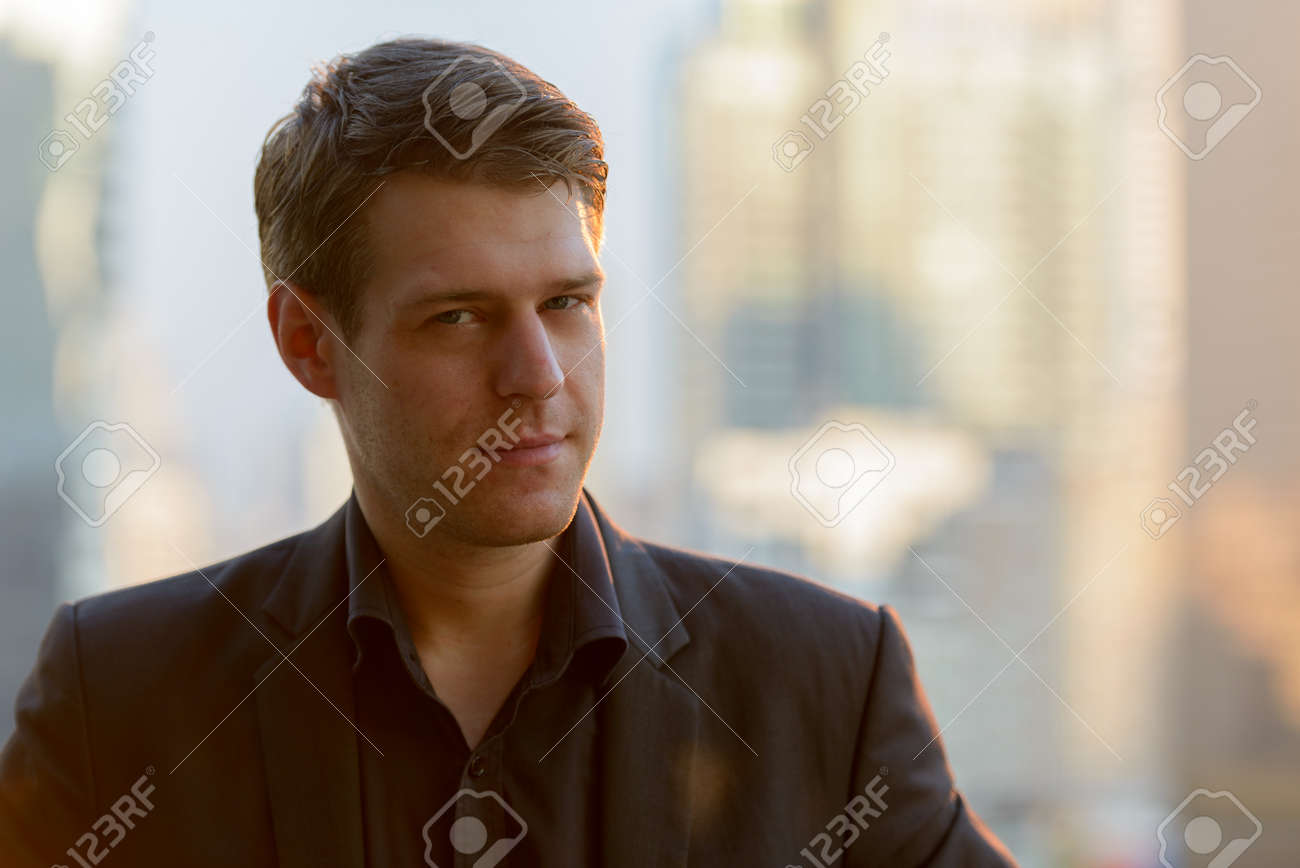 Face of young handsome businessman against view of the city - 145820545