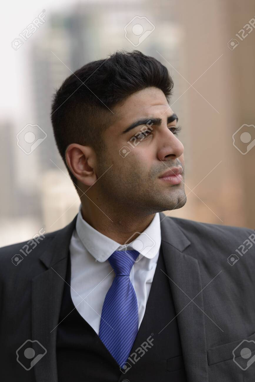 Face of young handsome Indian businessman thinking in the city - 150528350