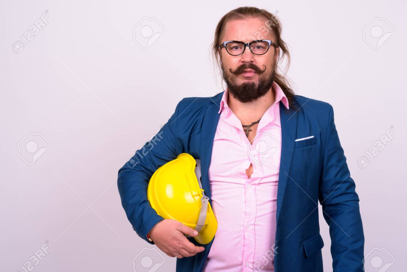 Bearded businessman with hardhat against white background - 152727377