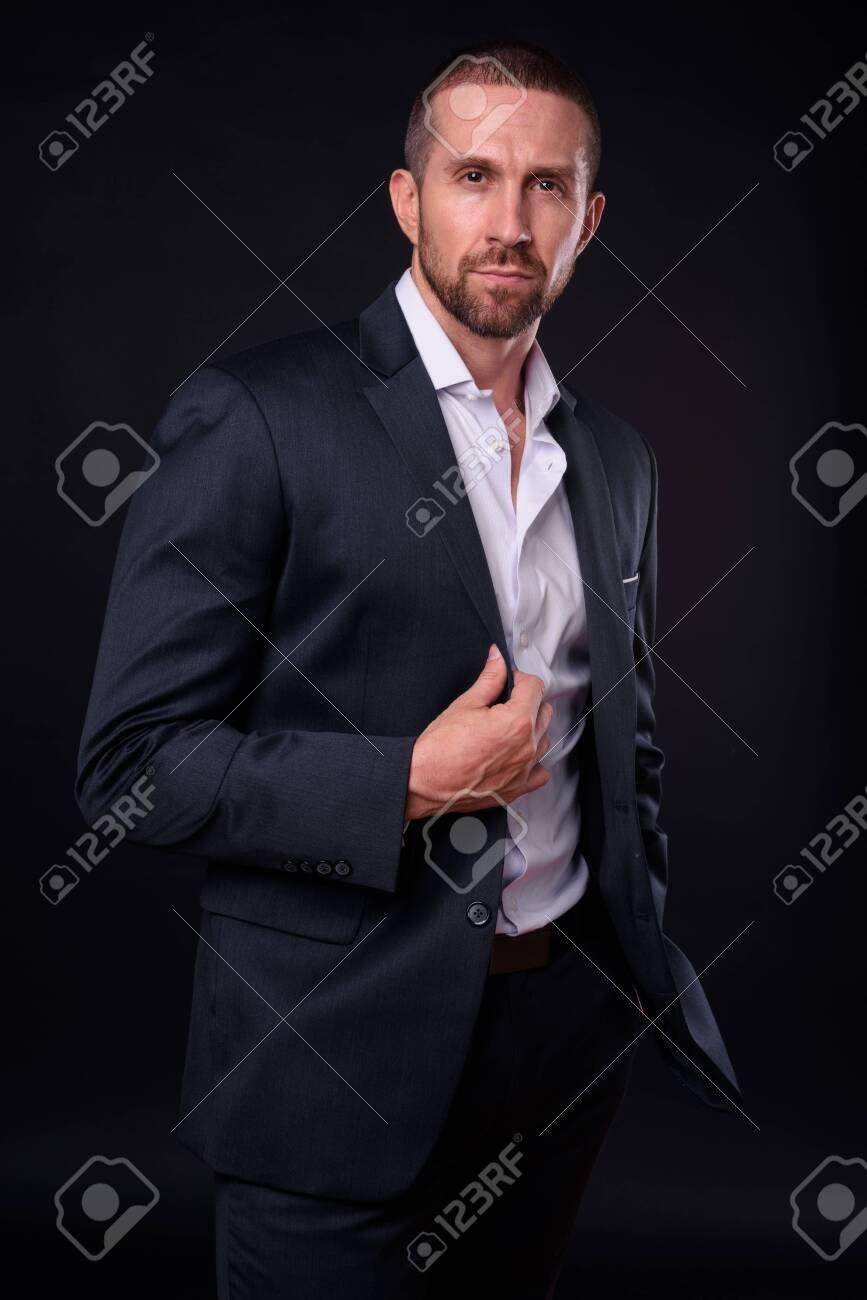 Portrait of handsome bearded businessman in suit - 152801950