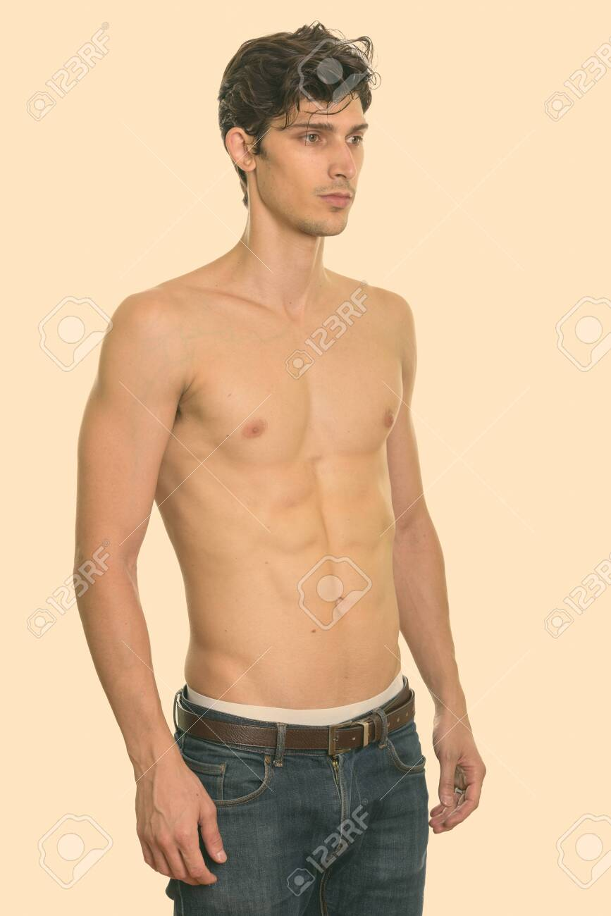 Studio shot of young handsome man standing and looking at right shirtless - 158255951