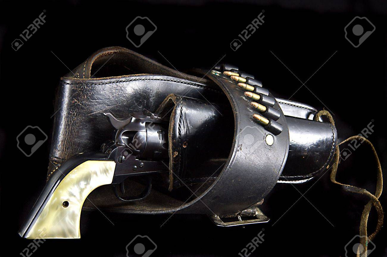 An old western six gun revolver isolated against  a black background in the horizontal format. Stock Photo - 5248251