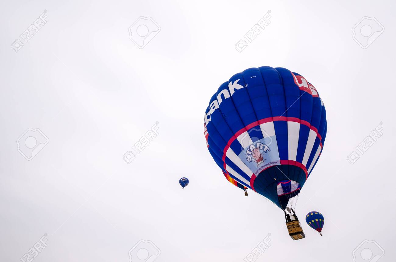 Colorful hot air balloons prepare to launch at the Hudson Hot Air Affair in winter - 138708332