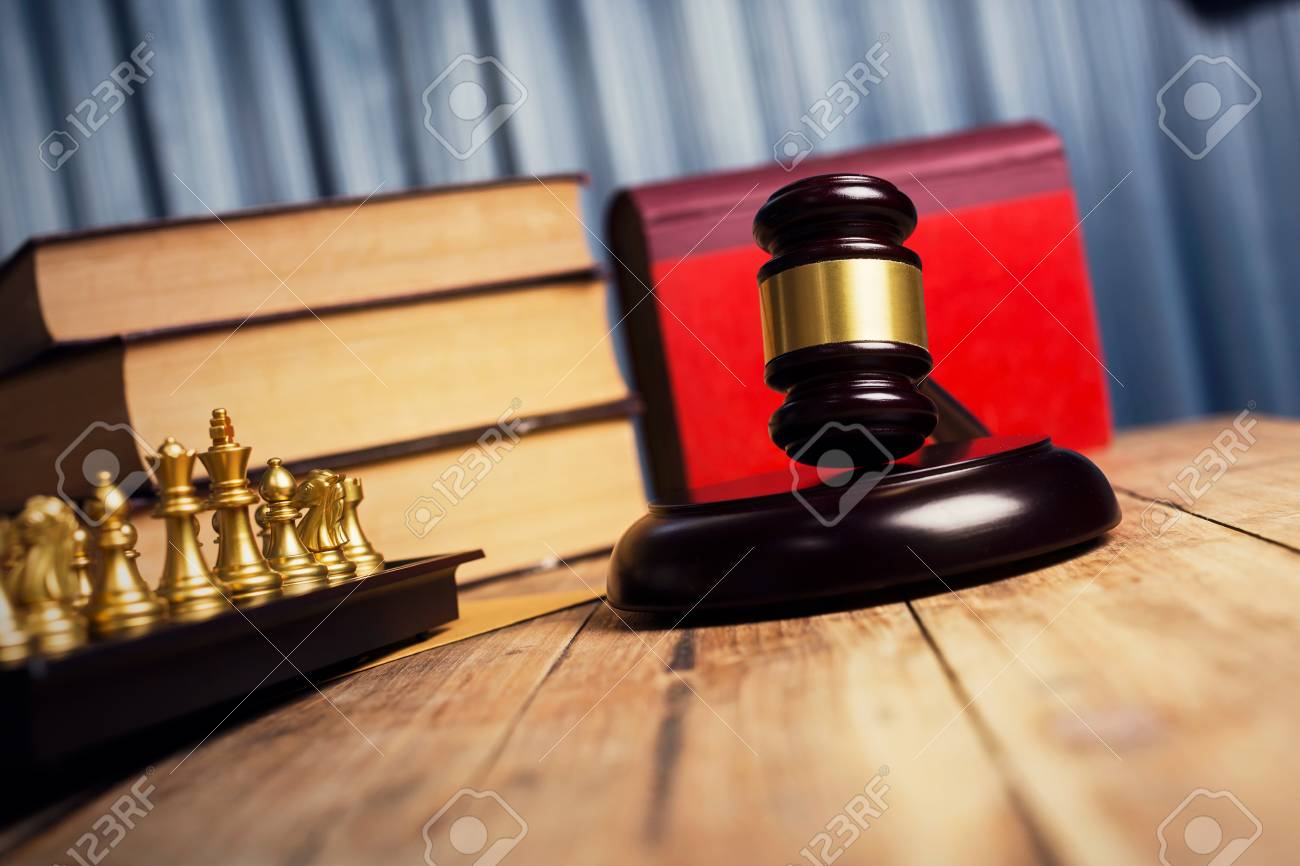 Judge Gavel On Old Weathered Wood Table With Vintage Book And..
