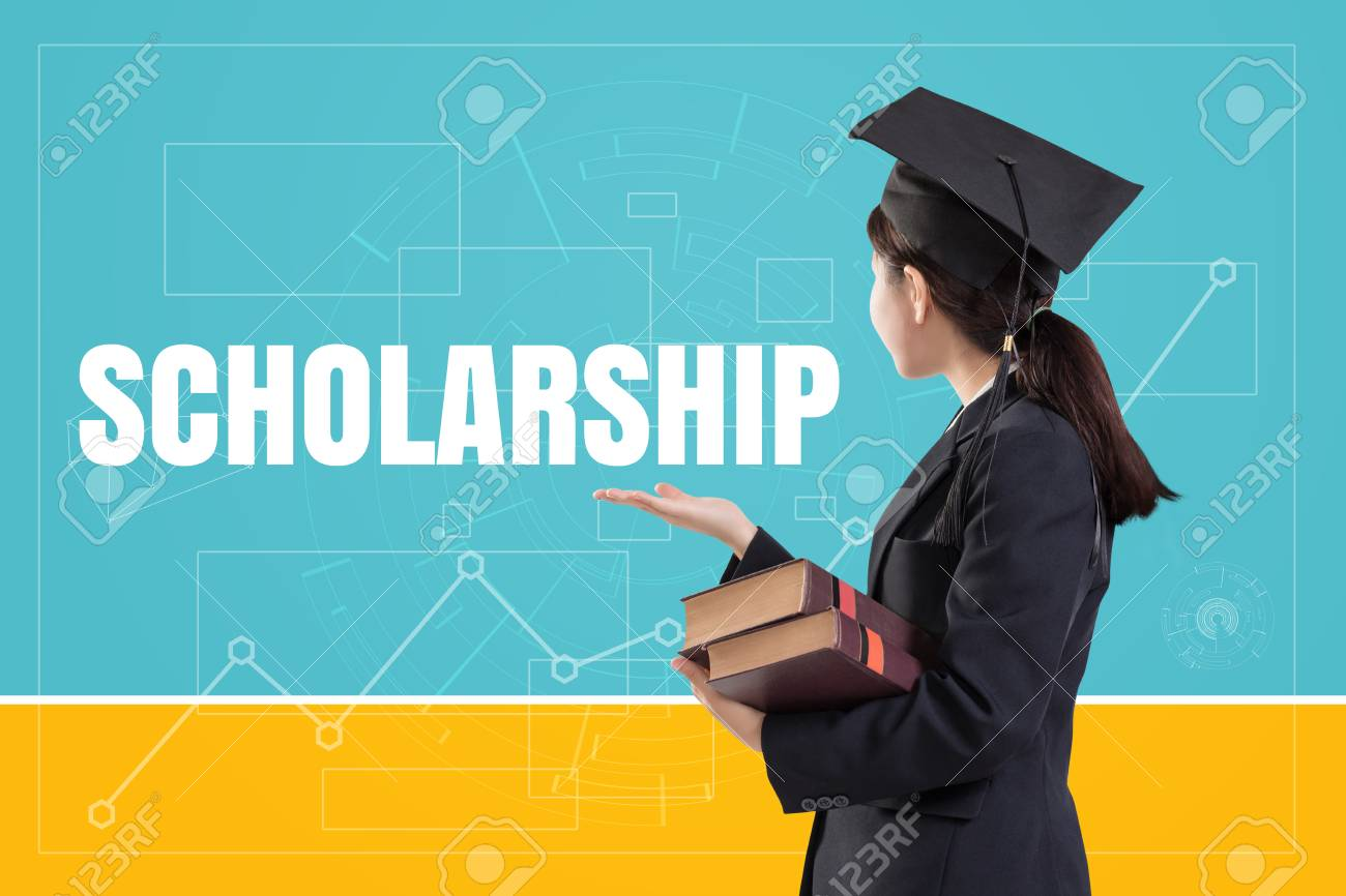 Graduated female girl holding the books with text: Scholarship - 68541214
