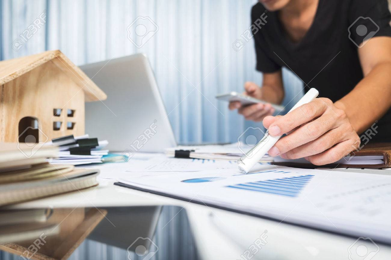 Manager working in the office ,property for sale concept. - 75500778