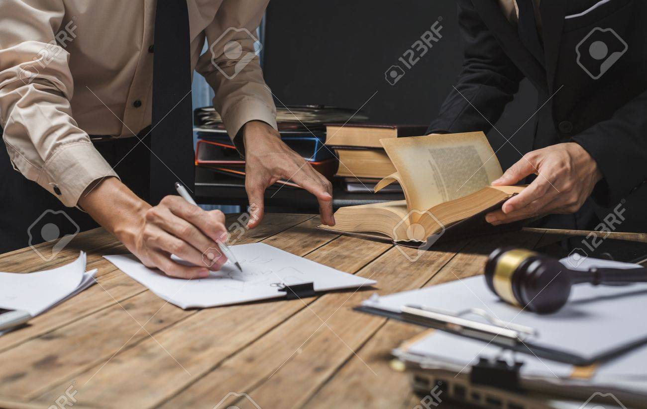 Teamwork of business lawyer meeting working hard about legal regislation in courtroom to help their customer. - 75575290
