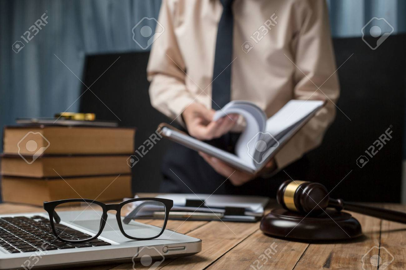 Business lawyer working hard at office desk workplace with book and documents. - 80131729