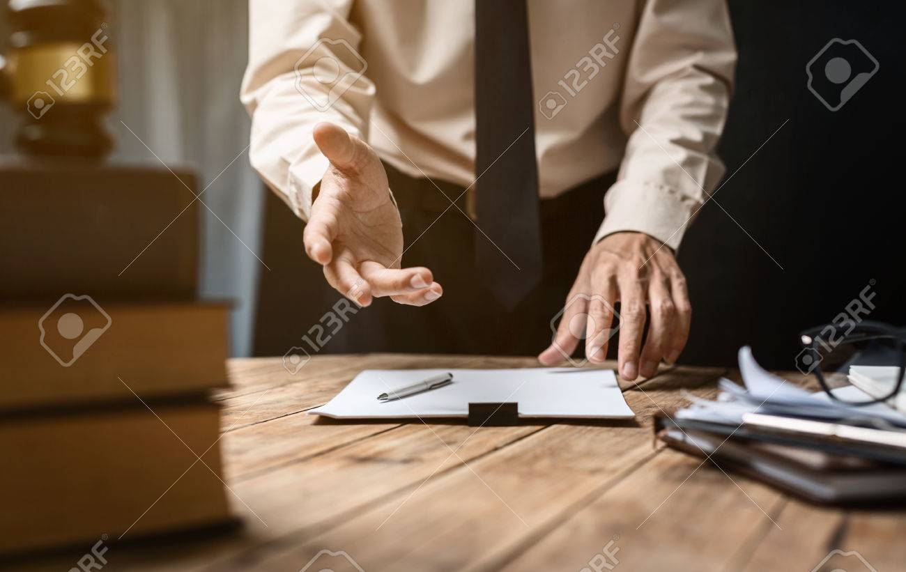 Business lawyer working hard at office desk workplace with book and documents. - 81288861
