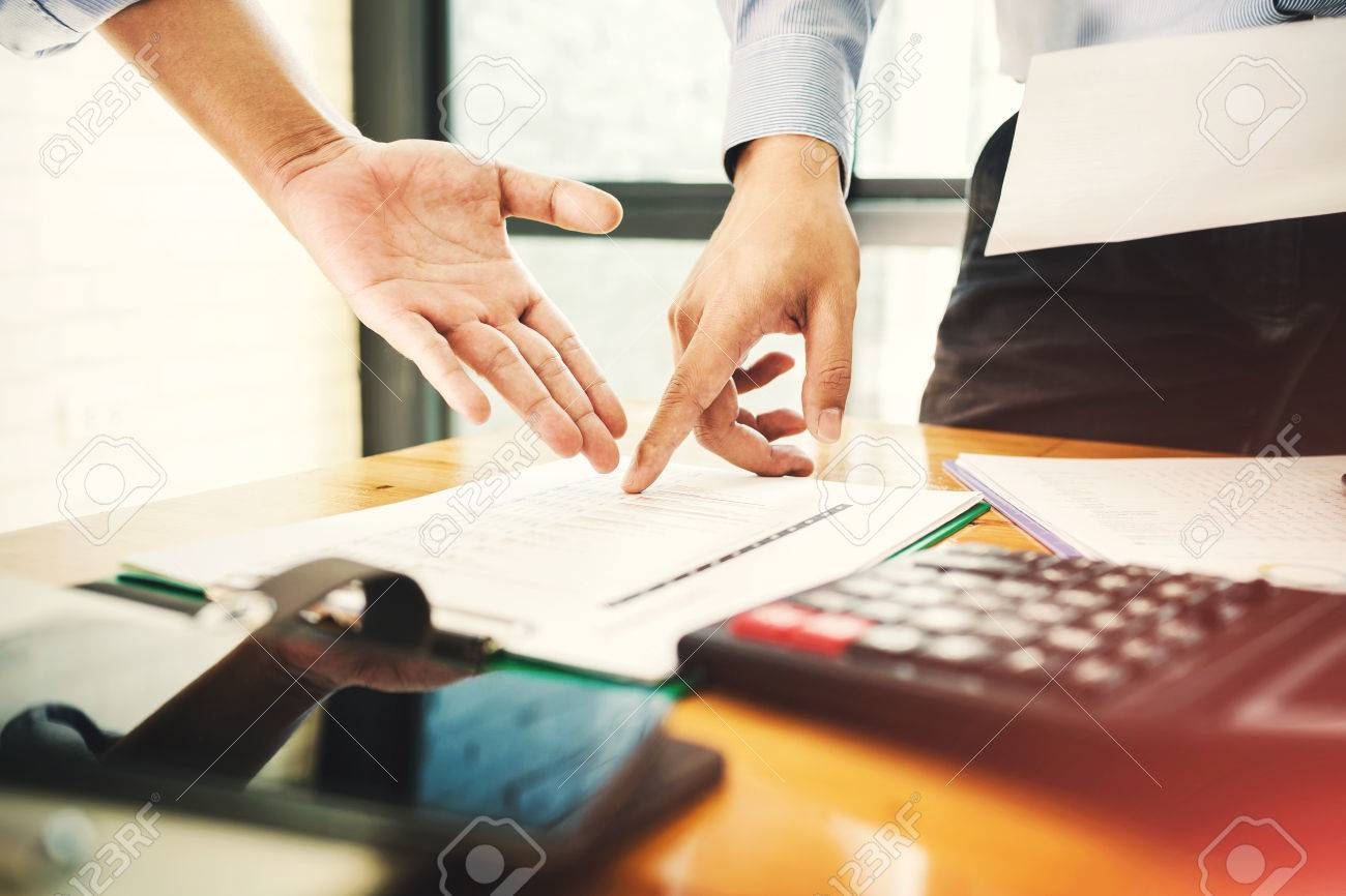 Teamwork businessman officer working hard investing financial reports and calculating colleagues for successful project. - 81288916