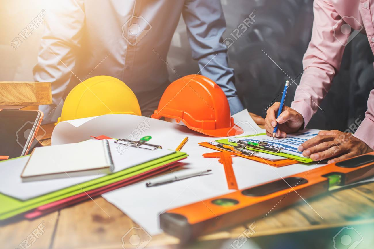Structural engineer teamwork discussing hardworking in the office on building structure concept of worldwide building project. - 84157015