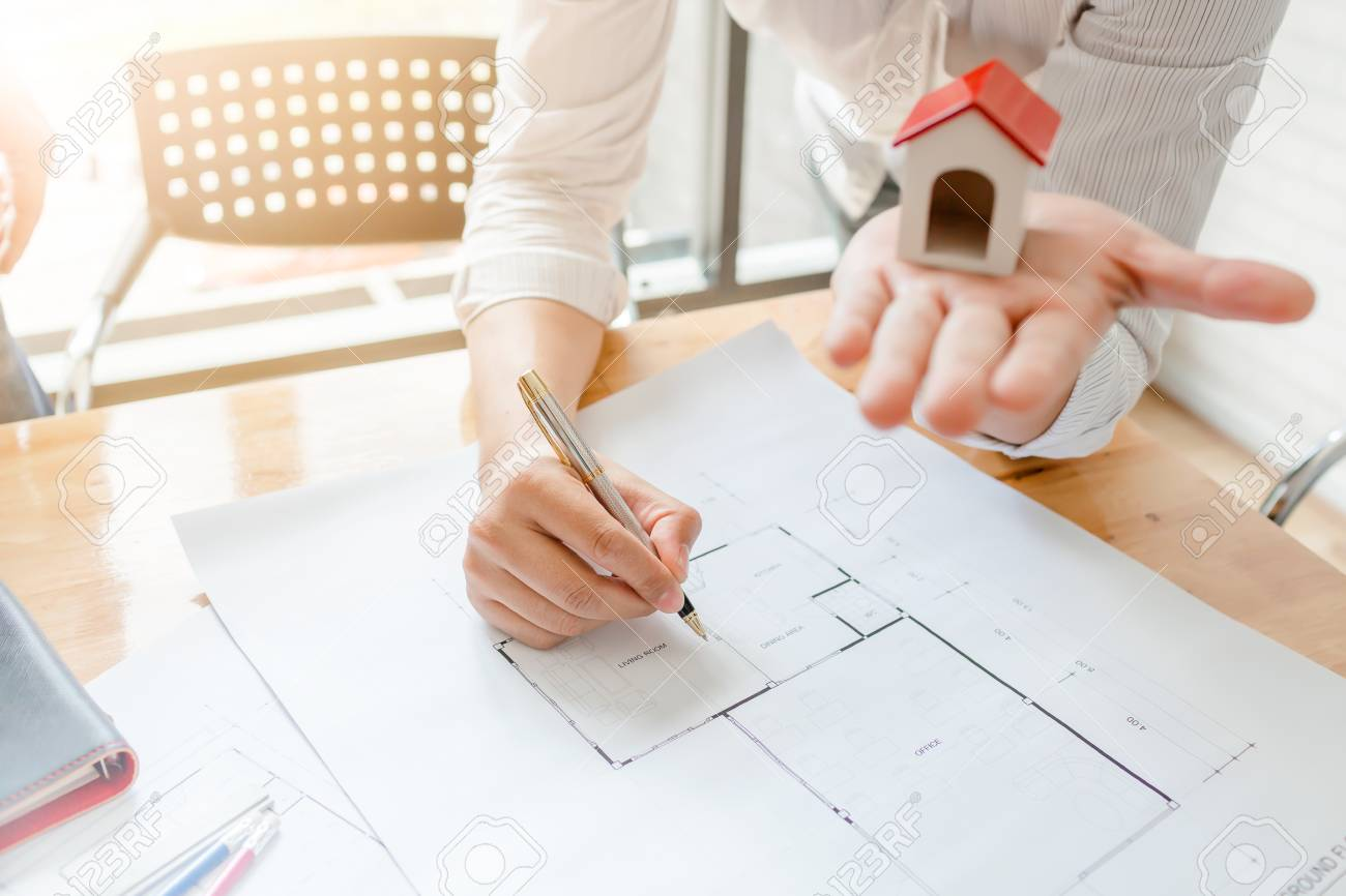 Business architect engineer drawing a house blueprint planning business architect engineer drawing a house blueprint planning to build a new home at housing estate malvernweather Images