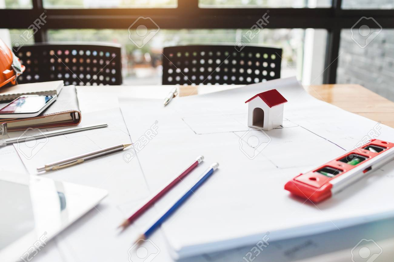 Desk of architect house engineer building a blueprint on working desk of architect house engineer building a blueprint on working project stock photo 89718981 malvernweather Images
