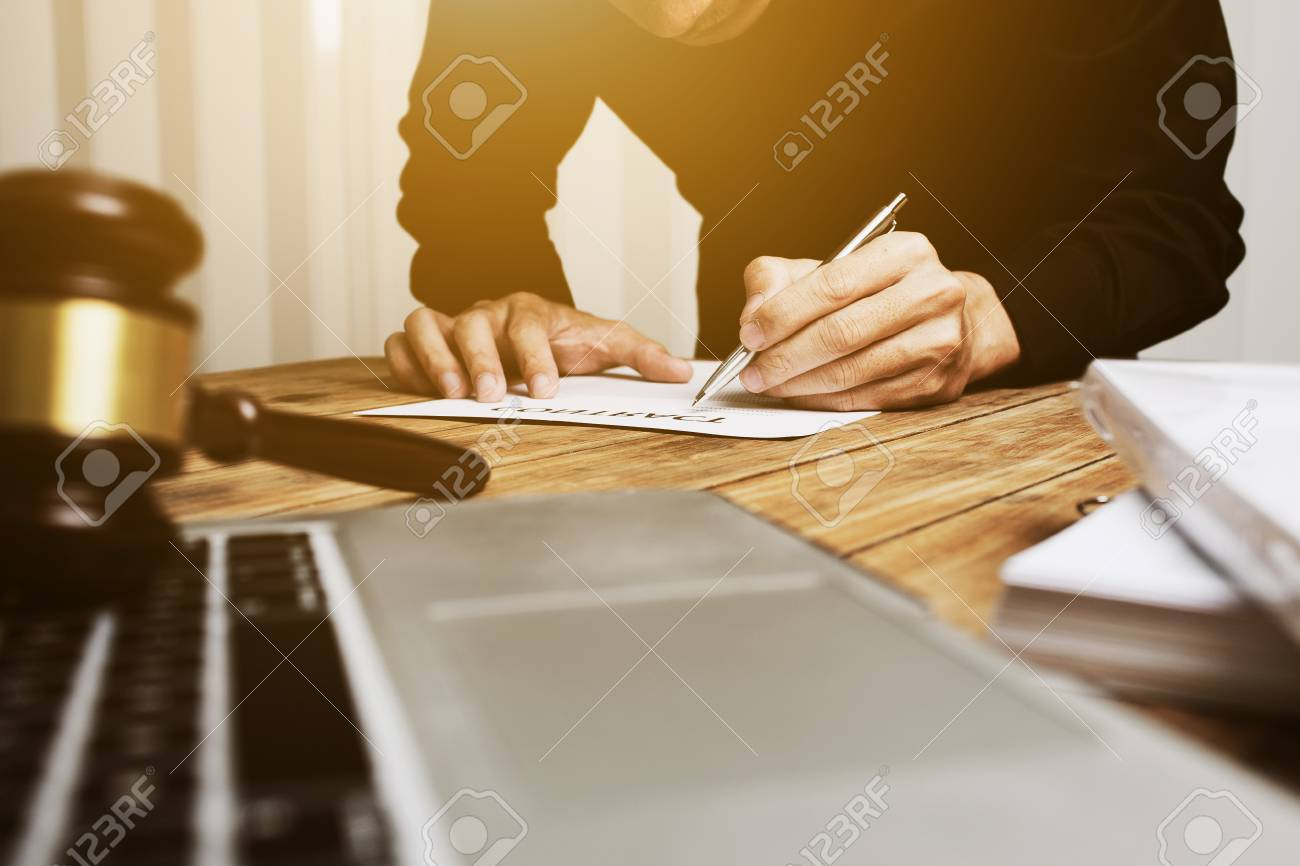 Young lawyer working hard alone in his office. - 92806195