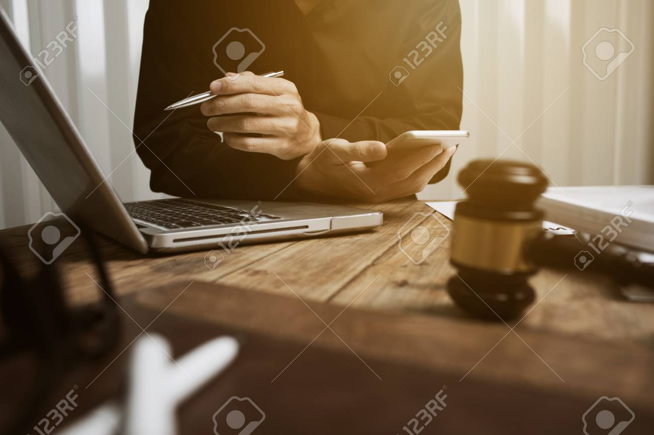 Young lawyer working hard alone in his office. - 93010058