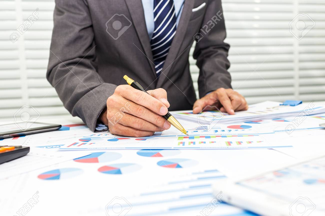 Bankers are recording financial information and balance sheet of the company to analyze the loan approval. - 93147871