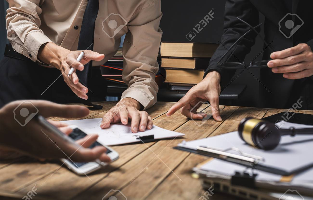 Teamwork of business lawyer meeting working hard about legal regislation in courtroom to help their customer. - 93009031
