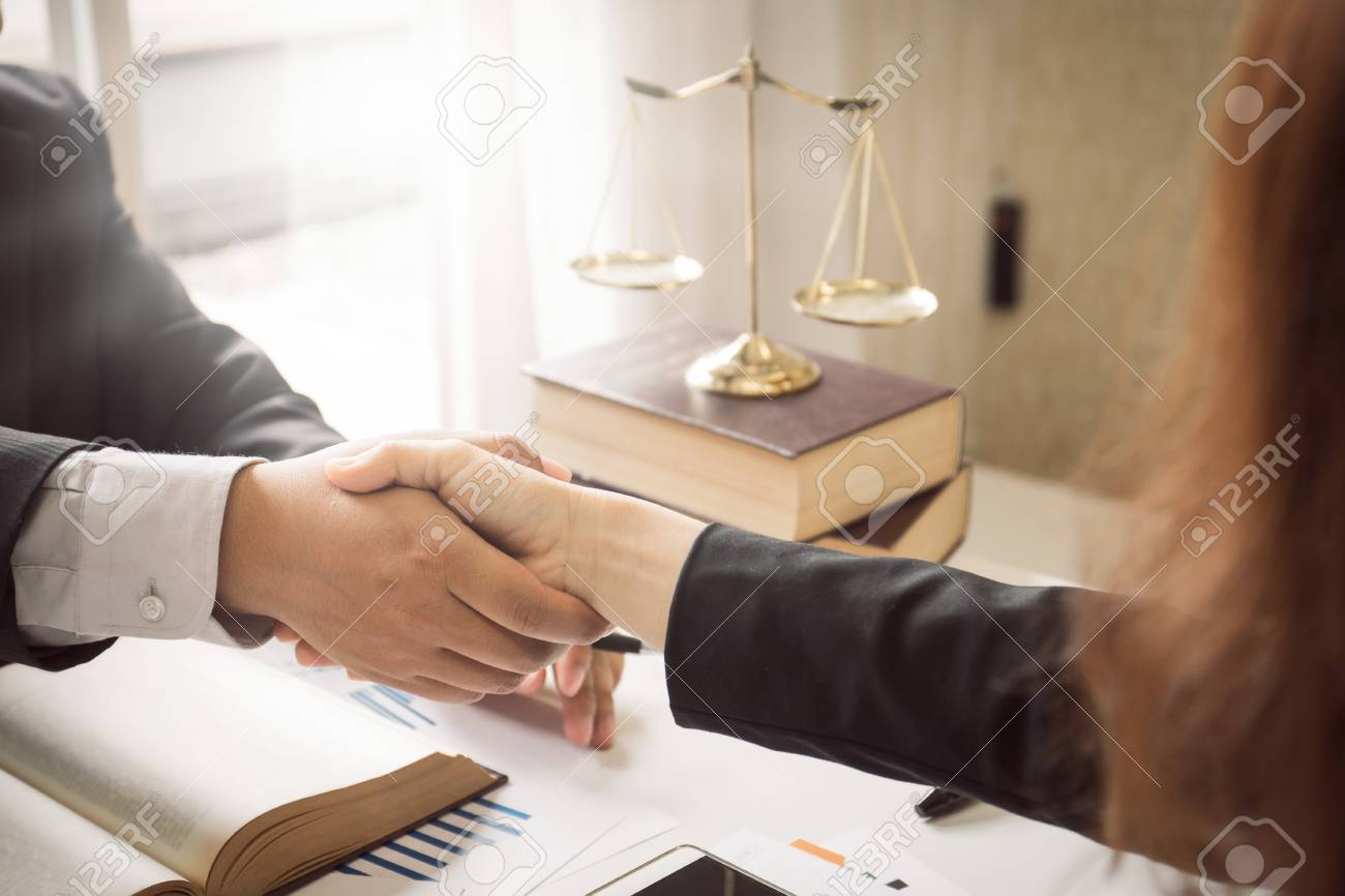 The hard work of an asian lawyer in a lawyer's office. Counseling and giving advice and prosecutions about the invasion of space between private and government officials to find a fair settlement. - 93009457