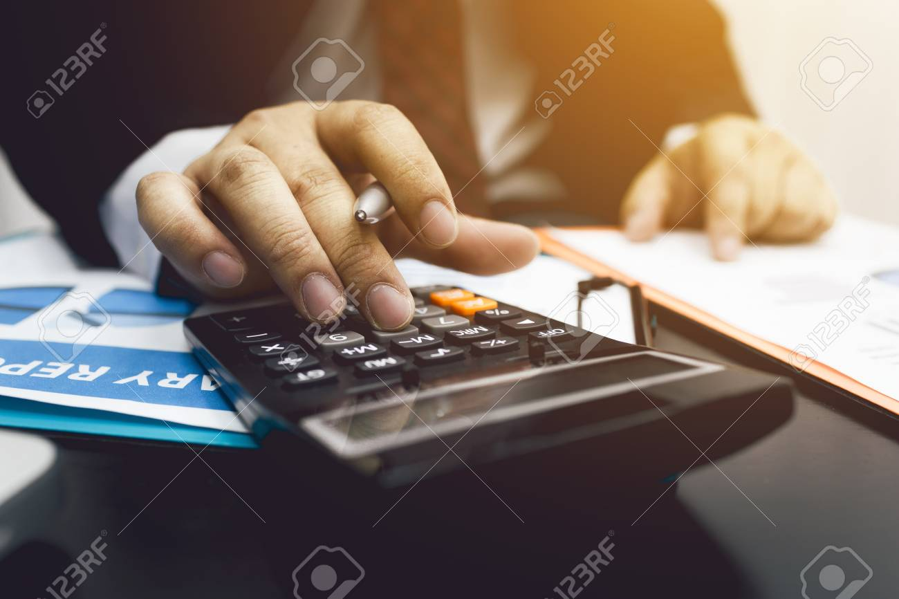 Business man accountant using calculator to calculating bugget money tax loan. - 93009060