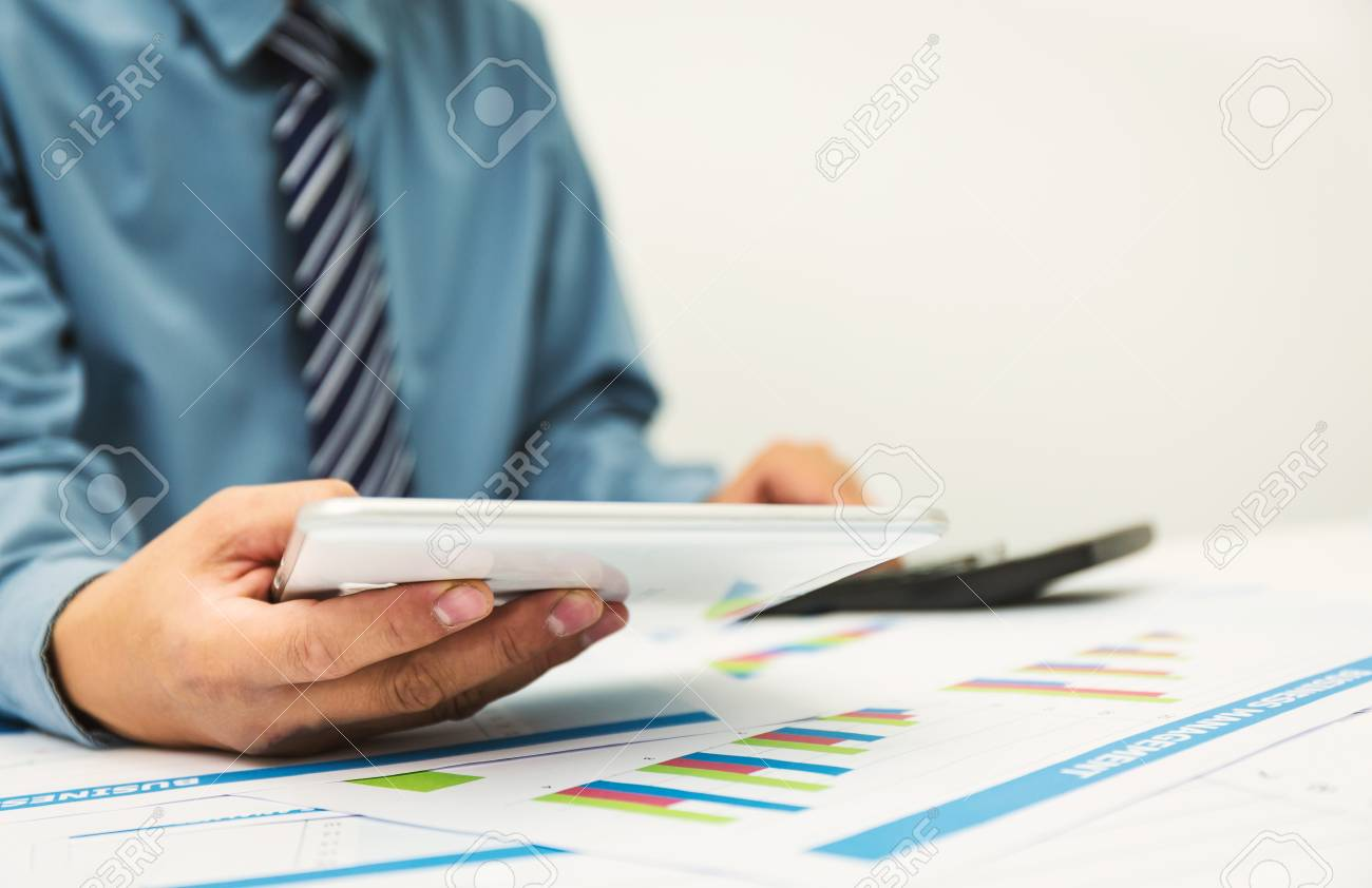 Businessman using a personal income tax calculator. To send.