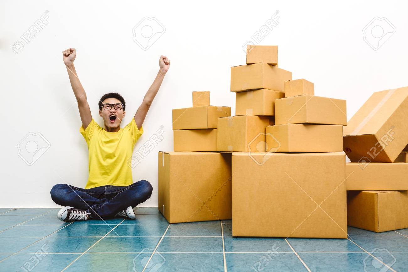 Asian man winner success as SME start up entrepreneur owner business with cardboard packaging box and delivery service. - 96593265