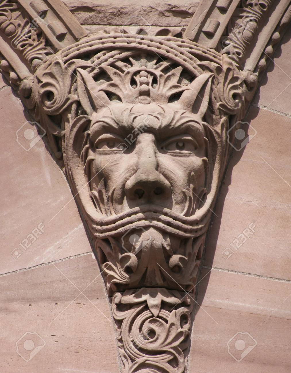 A not so fierce looking gargolye on the front of the parliament buildings, Toronto, Ontario, Canada. Stock Photo - 4759527