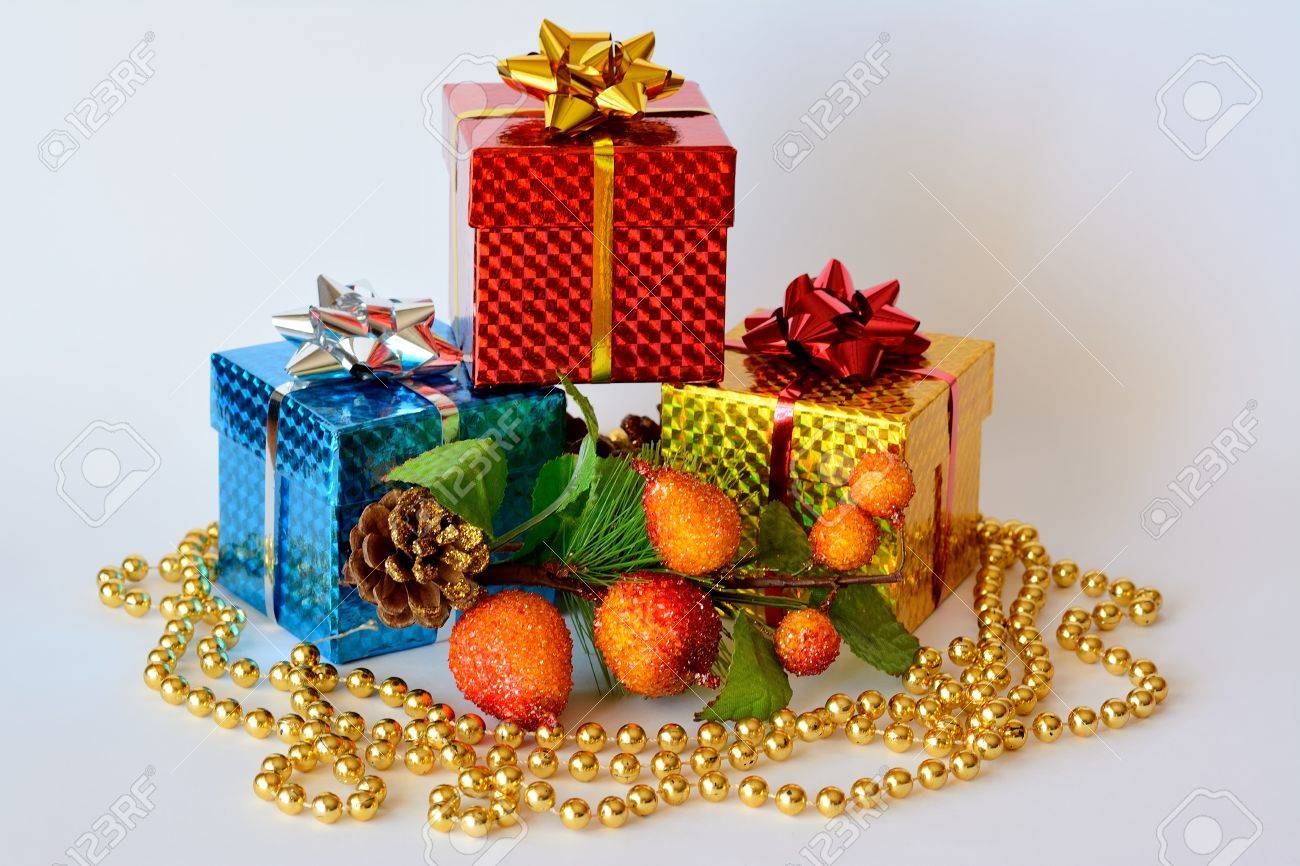 Three Gift Boxes Decorated With Christmas Motifs And Golden Pearl ...