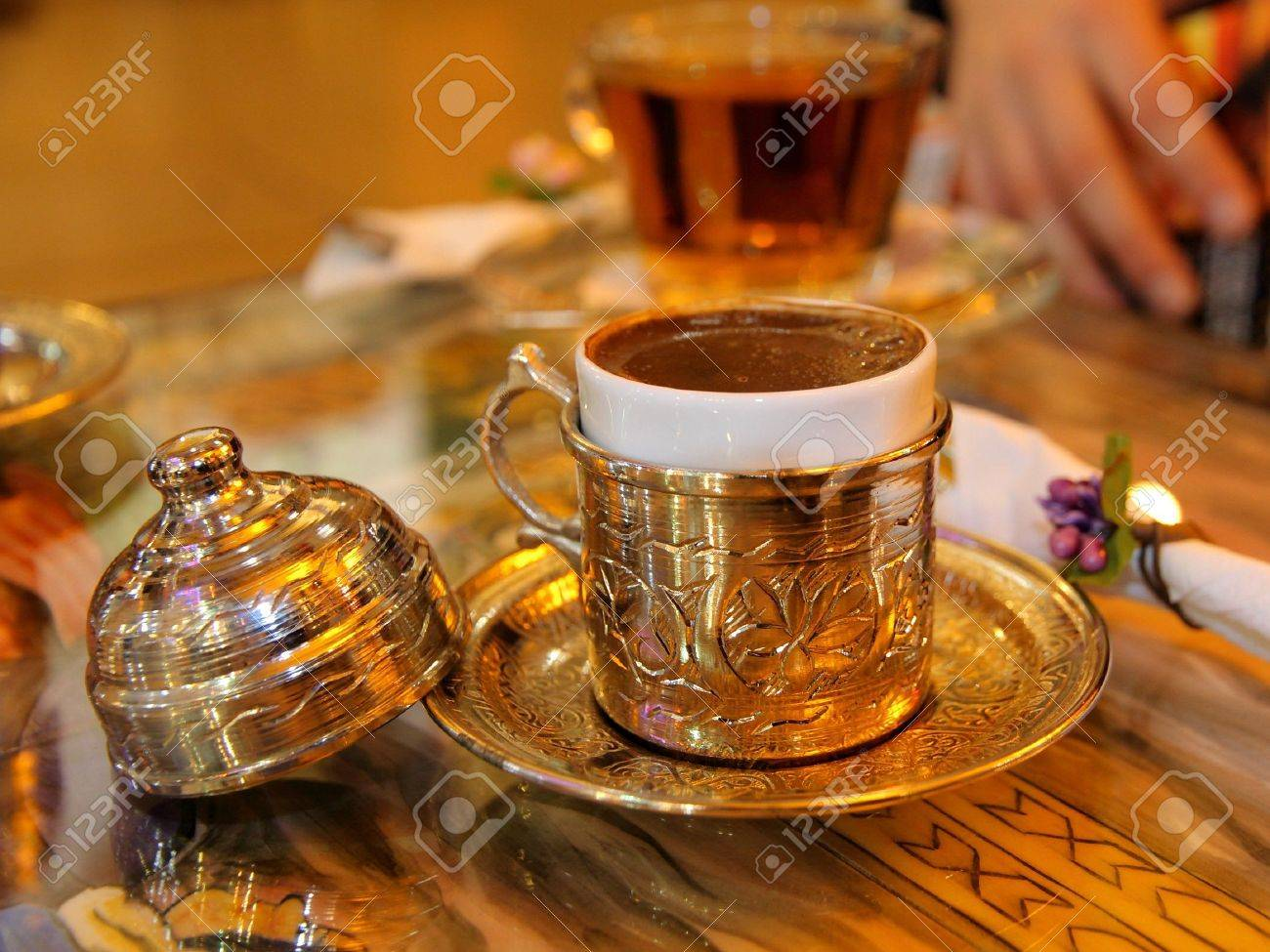 turkish coffee served in a traditional turkish metall dish cap Stock Photo - 7211509