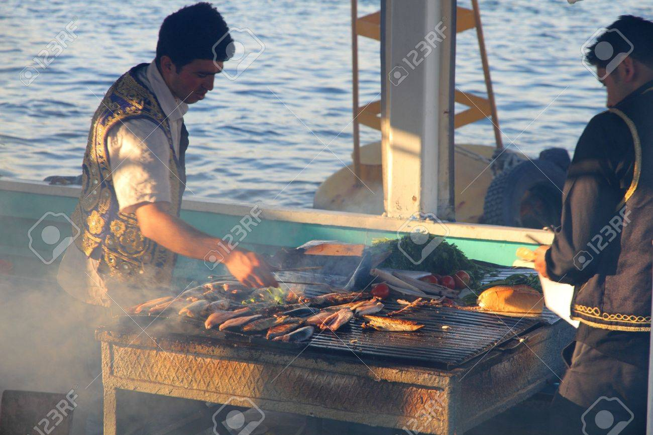men preparing  fish for the famous fried fish sandwiches in Istanbul harbor,Turkey Stock Photo - 7258045